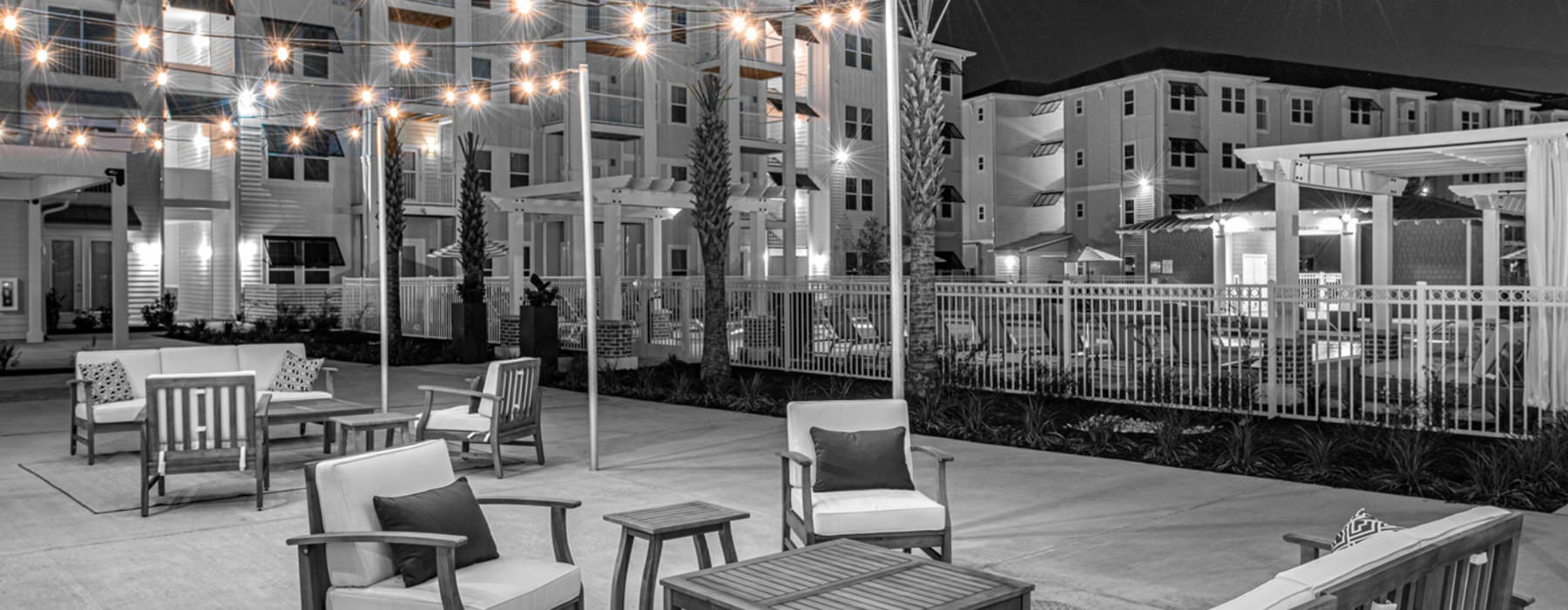 Outdoor space with ample seating and twinkle lights